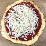 Mozzarella cheese added to a keto pizza crust
