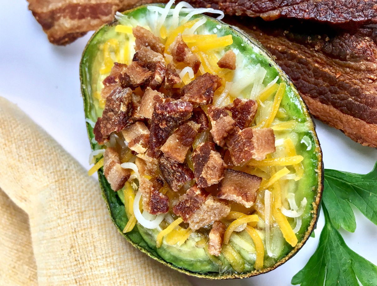 Are you looking for a delicious keto breakfast idea? These low carb loaded avocado baked eggs feature my favorite ketogenic ingredients - bacon, cheese, eggs and avocado!