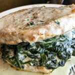 Are you looking for a hearty and delicious low carb dinner idea? This Creamed Spinach Stuffed Pork Chops recipe is the perfect keto meal.