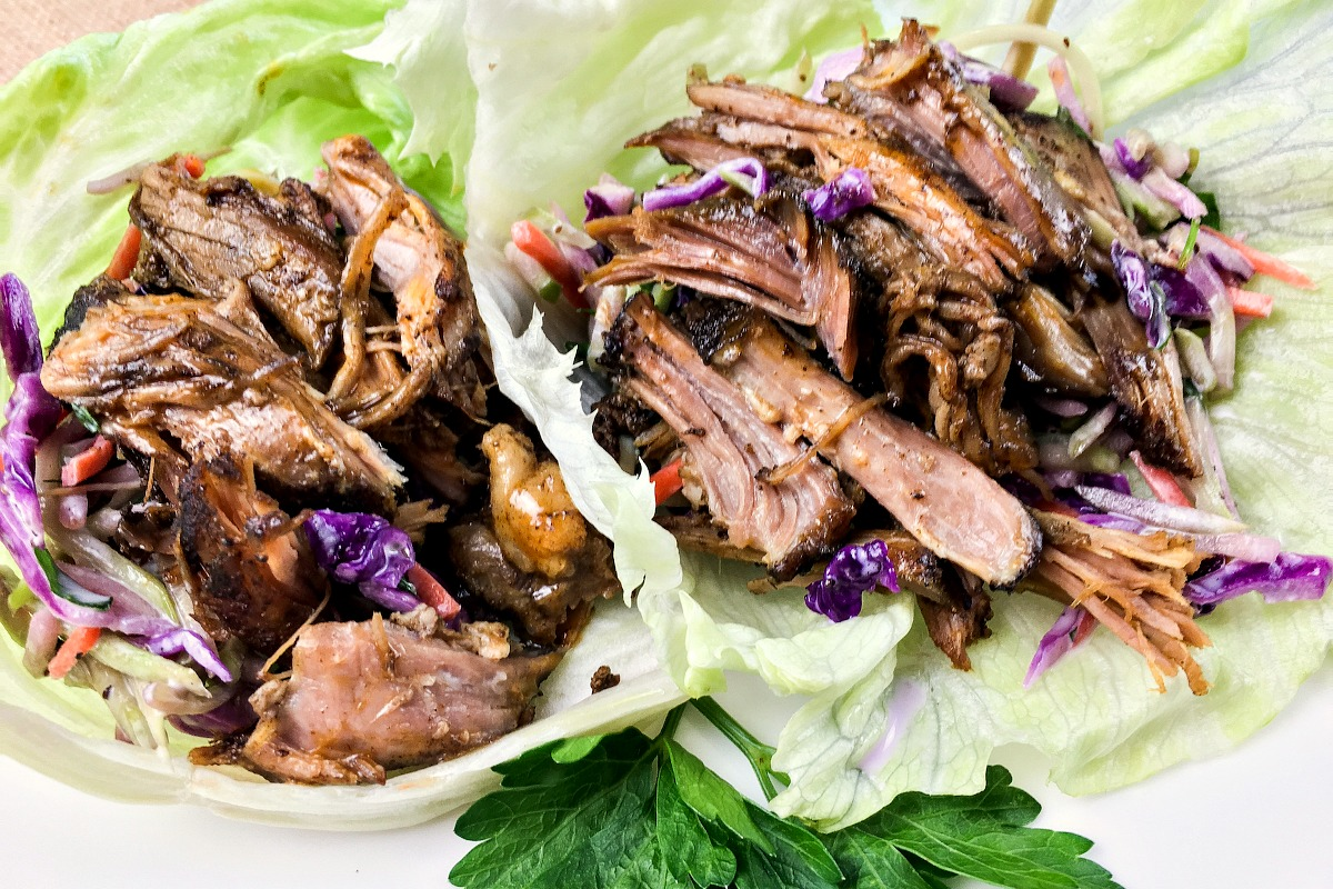 Are you looking for a delicious low carb meal idea to make in your crockpot? This low carb slow cooker pulled pork lettuce wraps recipe is keto diet friendly, delicious and almost effortless for ketogenic dinners!